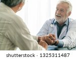 senior male doctor talking to...   Shutterstock . vector #1325311487