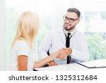 male doctor doing handshake...   Shutterstock . vector #1325312684