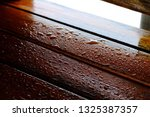 droplet of water on wood and... | Shutterstock . vector #1325387357