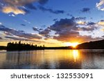 Sun Setting Over Tranquil Lake...