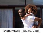 smiling african american man... | Shutterstock . vector #1325579501