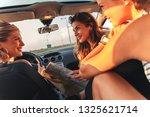three female friends enjoying... | Shutterstock . vector #1325621714