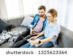 young couple dressed casually... | Shutterstock . vector #1325623364