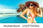 happy young woman wearing... | Shutterstock . vector #1325732561