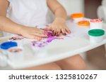 the child draws finger paints... | Shutterstock . vector #1325810267