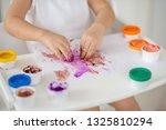 the child draws finger paints... | Shutterstock . vector #1325810294