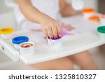the child draws finger paints... | Shutterstock . vector #1325810327