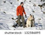 young man playing with husky... | Shutterstock . vector #132586895