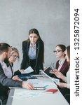 corporate teamwork. business... | Shutterstock . vector #1325872094