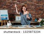 art hobby. studio workspace... | Shutterstock . vector #1325873234
