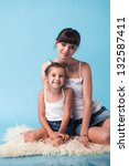 young mother with daughter on... | Shutterstock . vector #132587411