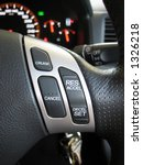 Small photo of Cruise control buttons integrated to the car's steering wheel.