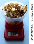 a refiner weighs his scrap gold ... | Shutterstock . vector #1326225521