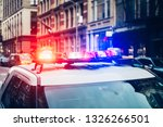 Police car with alarm and signal light flashes on the roof rush emergency call in New York City - stock photo