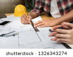 group of two coworkers working... | Shutterstock . vector #1326343274