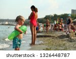 childs are resting on the... | Shutterstock . vector #1326448787