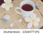 cup of dark tea on bamboo... | Shutterstock . vector #1326477191