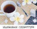 cup of dark tea on bamboo... | Shutterstock . vector #1326477194