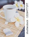 cup of dark tea on bamboo... | Shutterstock . vector #1326477197