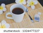 cup of dark tea on bamboo... | Shutterstock . vector #1326477227