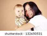 young mother with her baby... | Shutterstock . vector #132650531