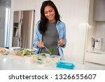woman in kitchen preparing high ... | Shutterstock . vector #1326655607