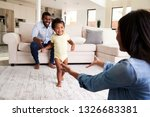 family at home encouraging baby ... | Shutterstock . vector #1326683381