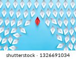 Small photo of Business competition, successful businessman concept with Red paper ship floating overtake the other white paper ships on blue background.