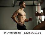 muscular build athlete warming... | Shutterstock . vector #1326801191