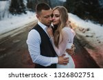 couple hugging against the... | Shutterstock . vector #1326802751