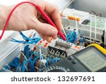 hand of an electrician with... | Shutterstock . vector #132697691