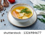 chicken soup bouillon in a plate | Shutterstock . vector #1326984677