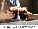 couple with glasses of cold... | Shutterstock . vector #1327121687