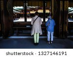 Stock photo two old japanese women praying at the famous meiji shrine in tokyo japan old asian ladies offer 1327146191
