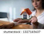 close up of real estate agent... | Shutterstock . vector #1327165637