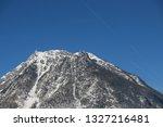the alps  peak against the sky | Shutterstock . vector #1327216481
