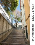 lisbon  alfama portugal... | Shutterstock . vector #1327217684