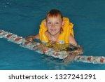 Boy In A Swimming Pool Wearing...