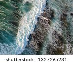 aerial view to ocean waves and... | Shutterstock . vector #1327265231