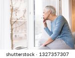 Mindful Mature Woman Sitting By ...