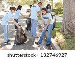 team of volunteers picking up... | Shutterstock . vector #132746927