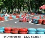 go kart racer on the track.... | Shutterstock . vector #1327533884