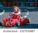 go kart racer on the track.... | Shutterstock . vector #1327533887