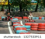 go kart racer on the track.... | Shutterstock . vector #1327533911