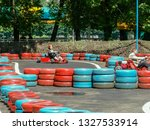 go kart racer on the track.... | Shutterstock . vector #1327533914