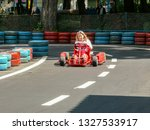 go kart racer on the track.... | Shutterstock . vector #1327533917
