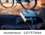 portable charger charges the... | Shutterstock . vector #1327573064