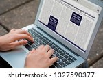 closeup of young woman reading...   Shutterstock . vector #1327590377