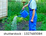 a man with a watering can ... | Shutterstock . vector #1327685084