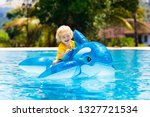 Child Playing In Swimming Pool. ...